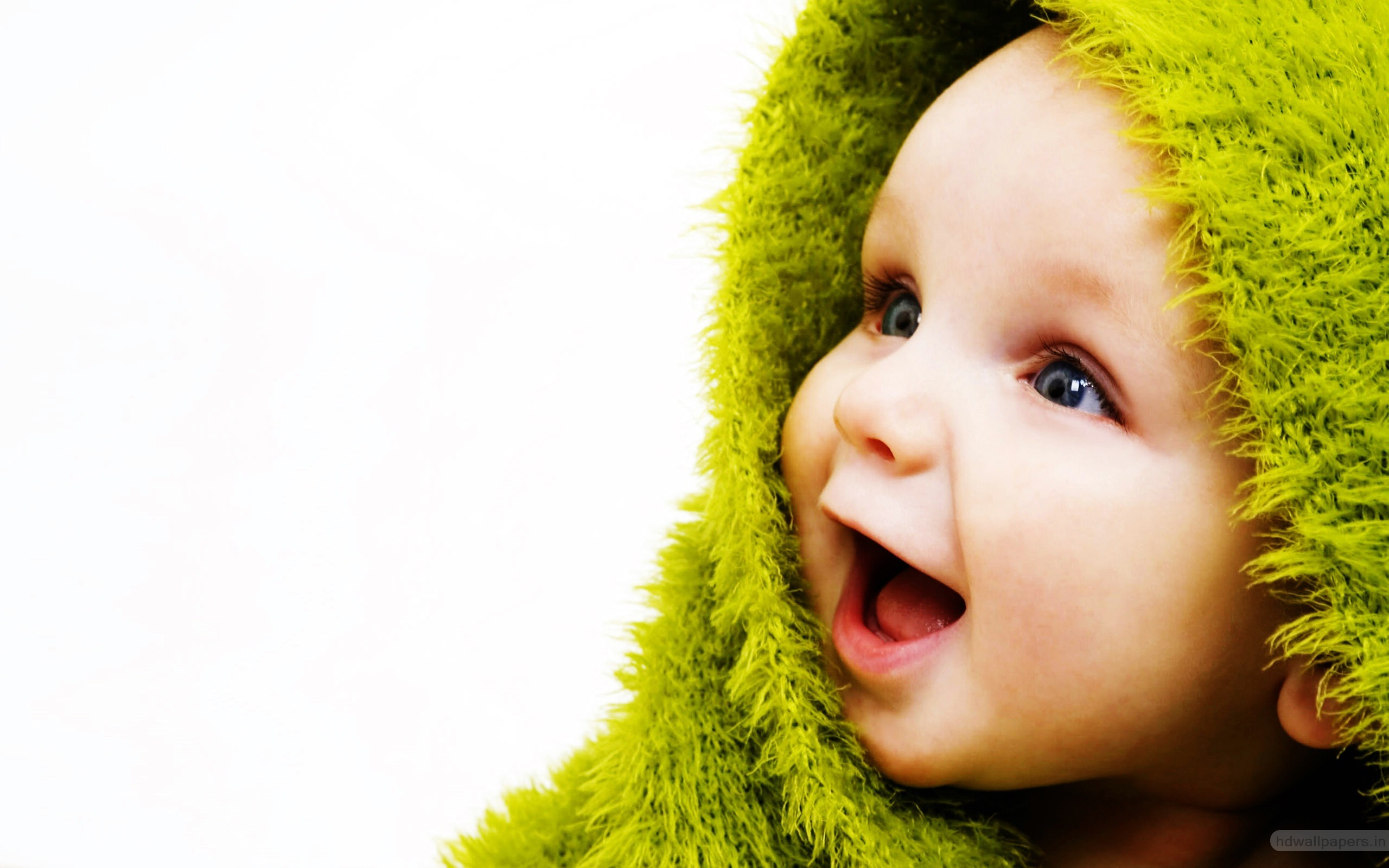 Cute Small Baby with Smile in Green Wallpapers