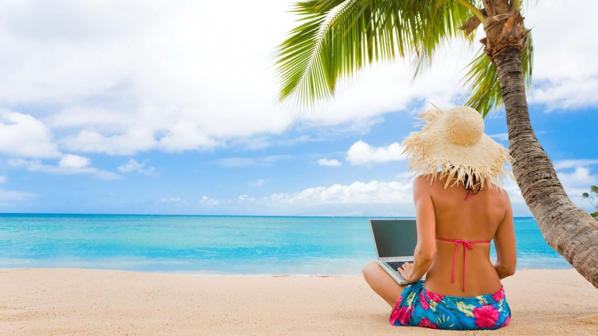 girl-using-laptop-in-tropical-beach-wallpaper