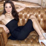 Popular French Hollywood Actress Marion Cotillard Seating on Sofa HD Photo